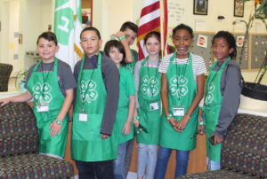 4-H Club Officers wearing green 4-h aprons