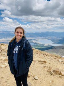 Alyssa standing on a mountain top