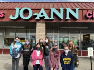 4-H participants in front of JoAnn Fabrics