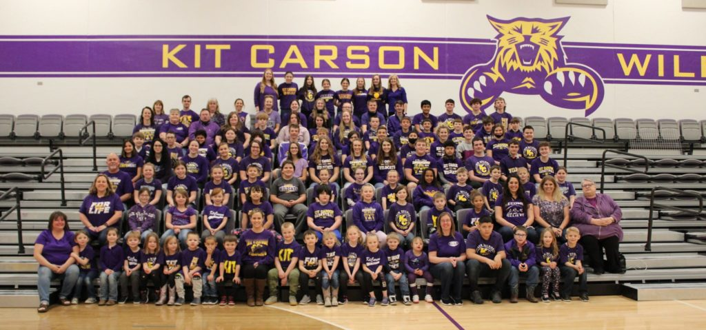 Kit Carson students wearing purple seated in the Kit Carson gym