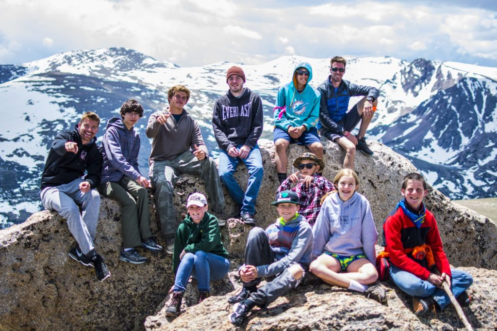 Teens participating inRocky Mountain Adventure Camp for military kids summit a mountain