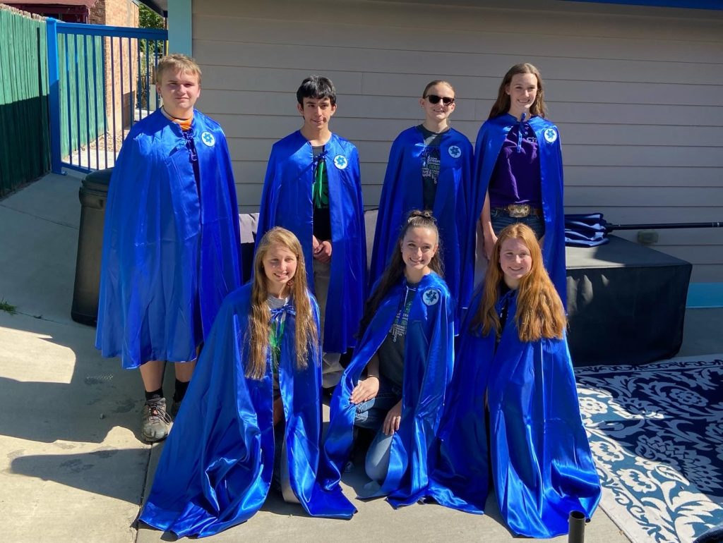 4-h participants wearing their blue capes