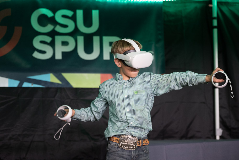 a child plays with a VR headset