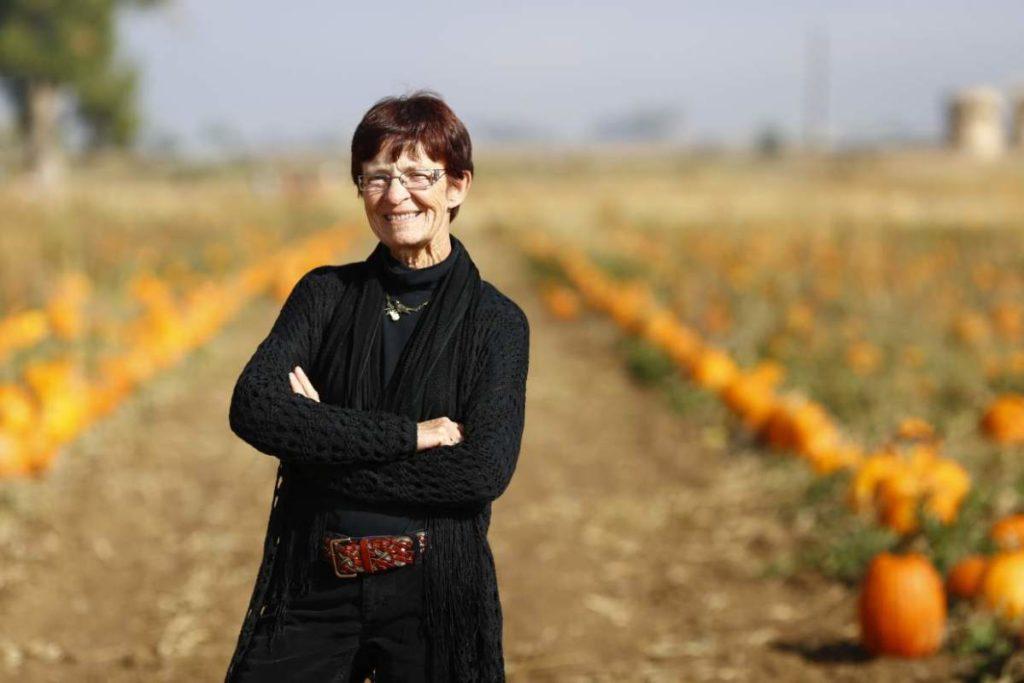 Kathy Rickart in a pumpkin patch
